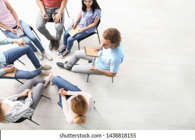 People at group therapy session