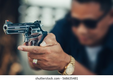 People with guns ready to fire