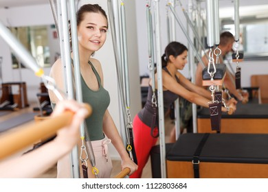 people in the gym with modern fitness equipment