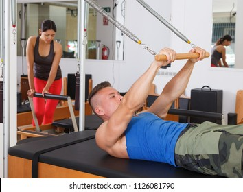people at gym with modern fitness equipment