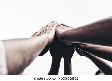 People hand assemble as a connection meeting teamwork concept. Group of people assembly hands as a business or work achievement. Man and women touch each other hands outdoor. Teamwork conceptual.