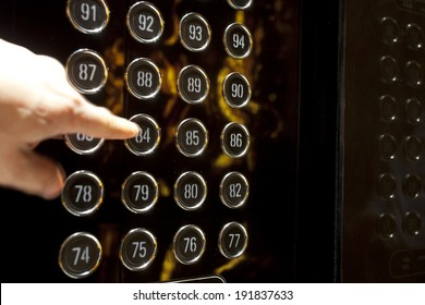 People hand press number floor in elevator