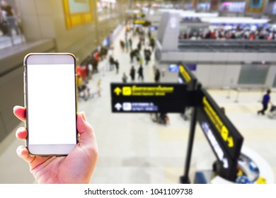 People hand use cellphone at the hall airport background with copy space on screen for using mobile app about activities in the airport or checking flight plan