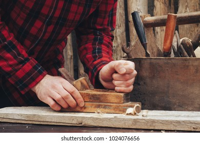 people handles a wooden Board