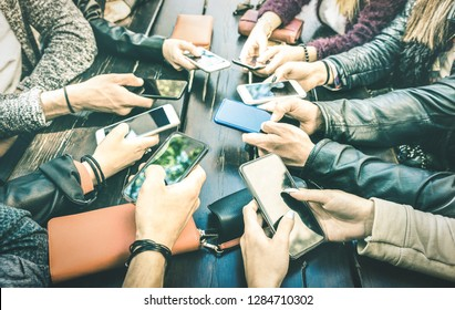 People hands having addicted fun together using smartphone - Millenial sharing content on social media network with mobile smart phones - Technology concept with millennials online on cellphone device