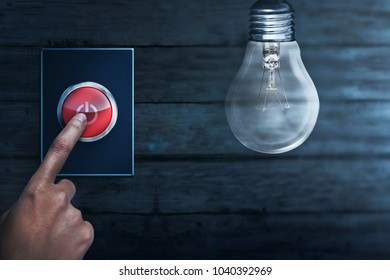 People hands turning off bulb light. Earth Hour Concept