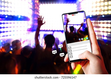 People hands use smart phones record video concert music festival live streaming video on internet to social media comment chat share with Friend