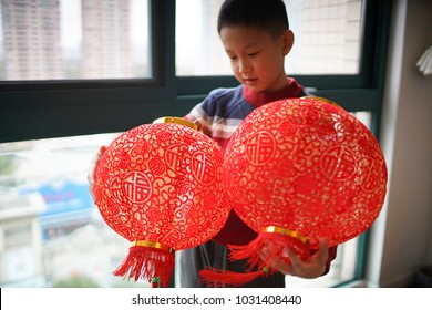 People hanging the red lantern when Chinese new year at home
