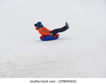 people have fun riding the snow slides on the tubing.