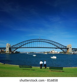 People have a rest in the middle of the day in from of the Sydney Harbour Bridge