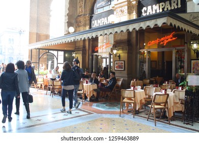 People having a coffee inside Galleria Vittorio Emanuele, Campari café  03.30.2018 - Milan, Italy.