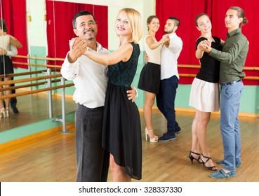 people having elegance dancing class in studio