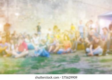 People having fun at music festivala. The blur effect.