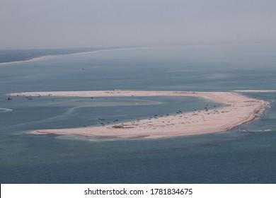 """People having fun in a sandbank next to """"troia peninsula"""","""