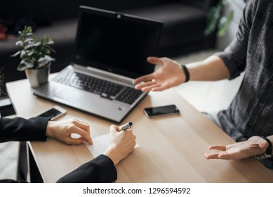 People having meeting in the office and explaining something or discussing