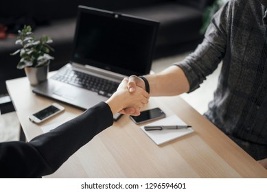 People having meeting in the office and shaking hands