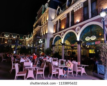 People having a rest in the evening in restaurants in Piazza, Batumi, Georgia - 28 Jun 2018: Piazza, is the center of events, official receptions and concerts.