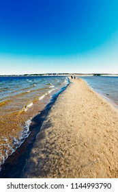 The people are having a walk on one of the long sandbanks at Kalajoki, Finland. The beach is famous for these sandbanks.