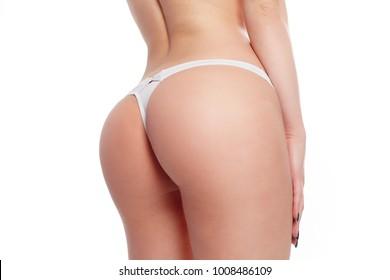 people, health and lifestyle concept - Beautiful Woman Body In Shape. Closeup Healthy Girl With Fit Slim Body, Soft Skin And Firm Buttocks, Hips In White Bikini Panties. Tight Big Butt In Underwear.