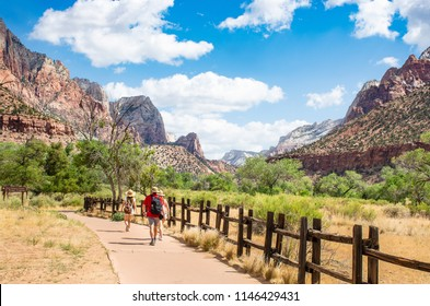 People  hiking  in the mountains. Family walking on pathway.  Zion National Park, Utah, USA