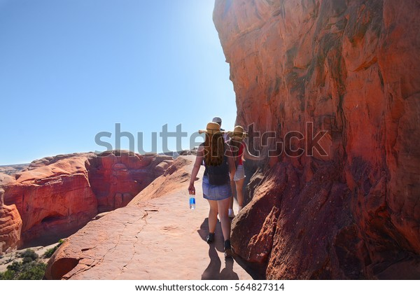 People Hiking On Delicate Arch Trail Stock Photo Edit Now