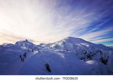 People hiking to the peak of Untersberg snow mountain in Salzburg at Austria