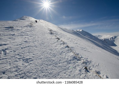 People hiking in Polish Western Tatra mountains during winter.g