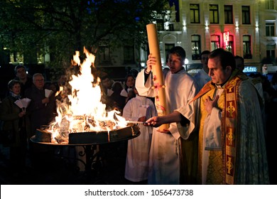 People hold candles during an Easter vigil mass in St. Catherine's Church in Brussels, Belgium on April 15, 2017.