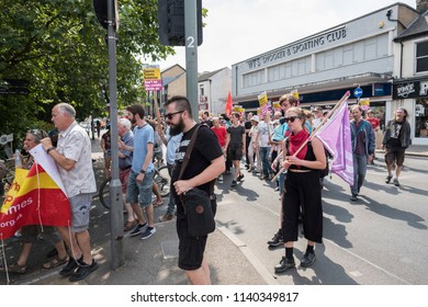 People hold signs opposing Tommy Robinson on the counter demonstration to the Free Tommy Robinson protest in Cambridge, United Kingdom, 21/07/18.