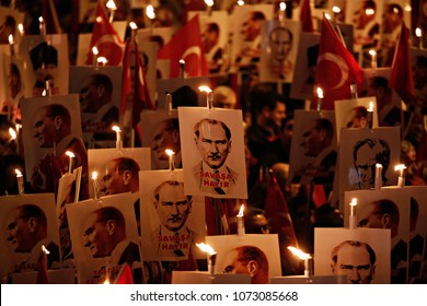 People hold torches and posters of Mustafa Kemal Ataturk, founder of modern Turkey during a march marking the 92th anniversary of Republic Day in Istanbul, Turkey on Oct. 29, 2015