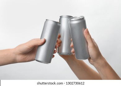 People holding aluminum cans on white background, closeup. Space for design