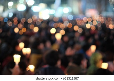 people holding candles