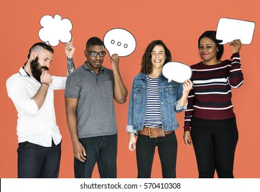 People Holding Chat Bubbles Smiling
