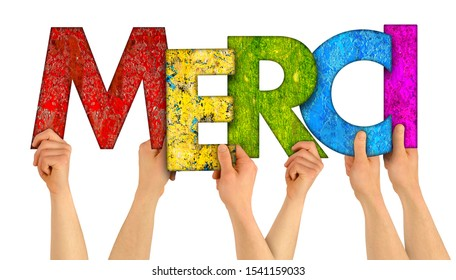 people holding up colorful rainbow wooden letter with the french word Merci (english traslation: thank you) isolated on white background. grateful happy love concept.