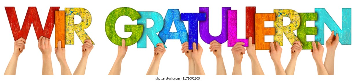 People holding up colorful wooden rainbow letter forming the german words WIR GRATULIEREN english translation we congratulate