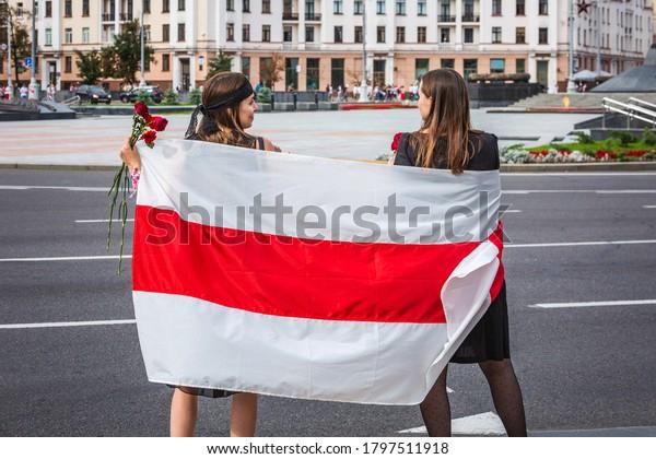 People holding flag during peaceful protests against stolen presidential elections in Minsk, Belarus.Minsk, Belarus - August 15 2020.