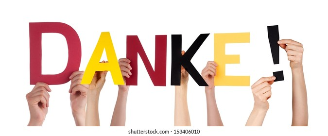 People Holding the German Word Danke Which Means Thanks in the Colors of Germany, Isolated