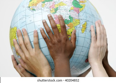 People holding up a globe
