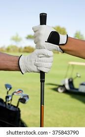 People holding golf club
