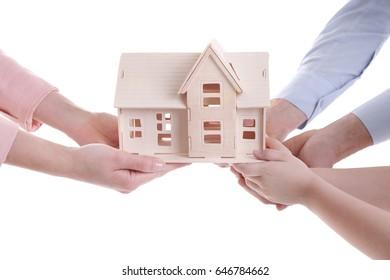 People holding house model on white background