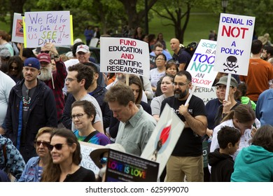 People holding protest signs at the March for Science in Austin, Texas on Saturday April 22, 2017.