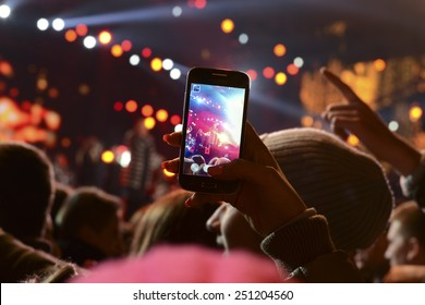 People holding their smart phones and photographing concert
