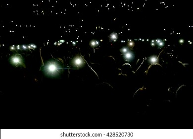 People holding their smart phones and photographing with flash