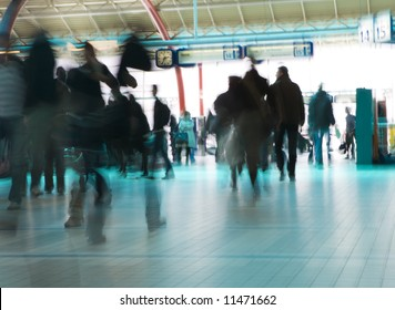 People hurrying to catch a train (or plane)