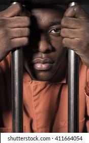 People In Jail - African american man behind bars