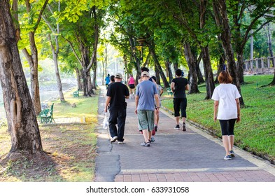people  jogging in the park on summer