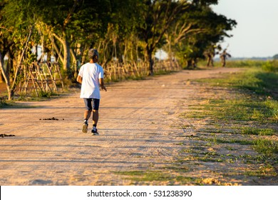 The people joging on the road at countryside on evening.