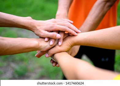 People join hands to express their unity.