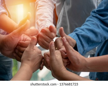 people join their hands together. Stack people's hands. Unity and teamwork, connection  concepts. closeup view.