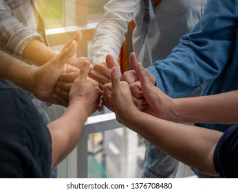 people join their hands together. Stack people's hands. Unity and teamwork concepts. closeup view.